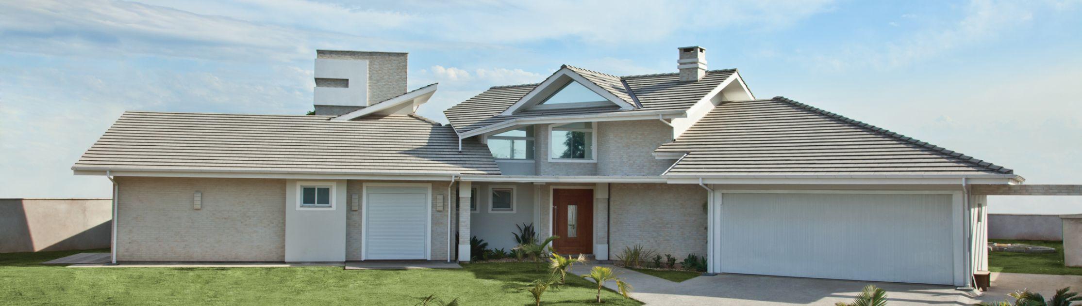 Imagem de uma casa com telhas Tégula